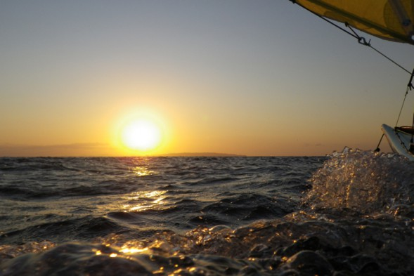sunrise, bow wake, and sail
