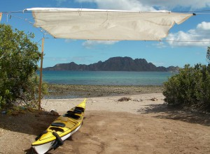 kayak on beach under canopy.