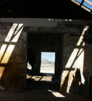 View through old building to the salt flat on Carmen Island