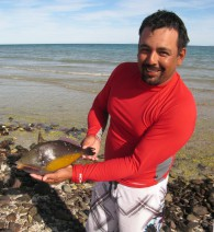 Marcos catches triggerfish by hand